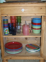Corcoran cabinet of kids' plates, bowls and cups!